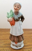 """Norleans Porcelain Figurine Elderly Lady with a Bunch of Carrots 5.25"""" VGC - $12.82"""