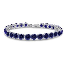 Simulated Sapphire Tennis Bracelet 6mm Round Cut Silver over Brass 7 inch - $44.40