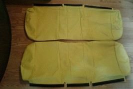 May be john deer?  Yellow side by side  bench seat covers 2 piece.