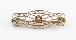 VINTAGE 10KT YELLOW GOLD DIAMOND IN AN ELABORATE LATTICE DESIGNED BROOCH... - $256.78