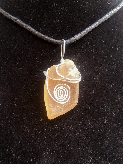 Strange Beholder necklace: Estonian sea glass with silver color wire spiral
