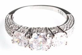 Sterling Silver Round Cut Three-Stone 7mm + 5mm Cubic Zirconia Engagement Ring