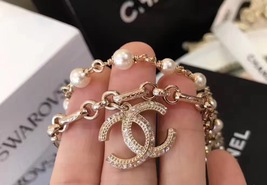 100% Authentic CHANEL 2017 Double Strand Pearl Bracelet CC Charm Gold image 3
