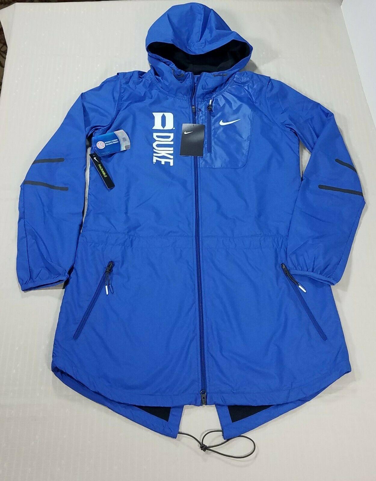 dcec745e 57. 57. Previous. Nike Duke Blue Devils Packable Knee Length Hood  Windbreaker Jacket Womens S Blue