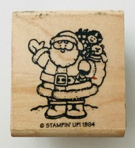 """Stampin Up Rubber Stamp Little Santa Claus with Bag of Toys 1994 1.25 x1"""" - $2.99"""