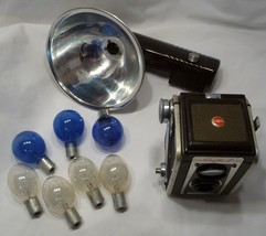 Kodak Duaflux IV camera with flash attachment and 7 flash bulbs - $24.98
