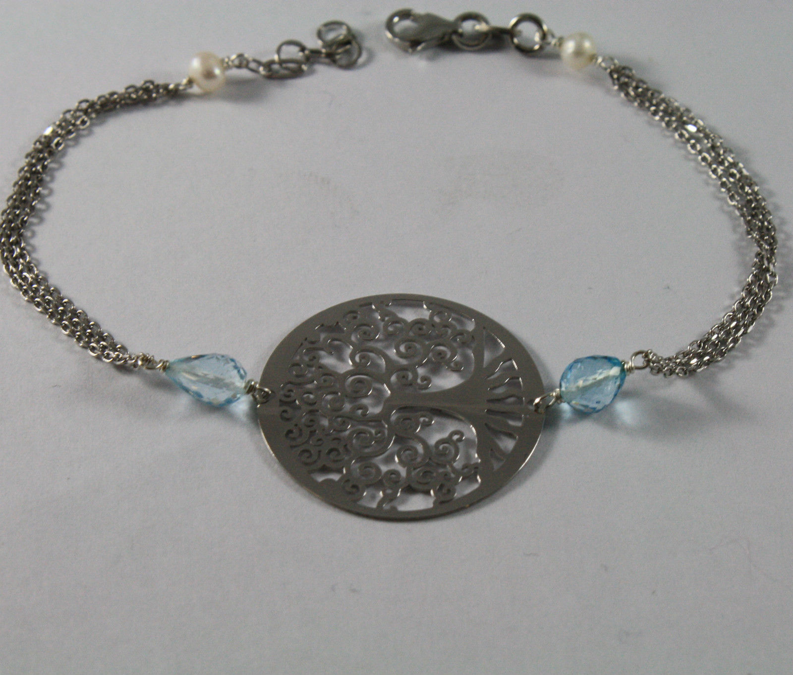 .925 RHODIUM SILVER BRACELET WITH DROP BLUE TOPAZ, FW PEARLS AND TREE OF LIFE