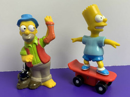 Lot of 2 Simpsons 1990s Fast Food Figures Bart Simpson Wind-Up Skateboard Homer - $9.89