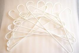 Seven White Plastic Hangers w/ Hooks - $2.99