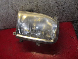 04 03 99 00 02 01 Nissan Pathfinder oem passenger side right headlight a... - $19.79
