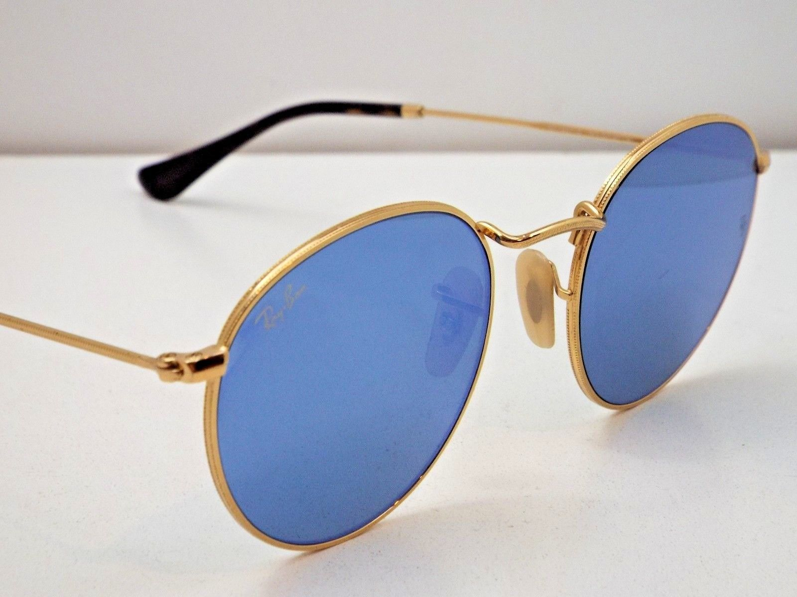 4927714.5. 4927714.5. Ray-Ban Sunglasses 3447N 001 90 50 Gold Frame  Blue  Mirror Lens Round · Ray-Ban ... 21cb8b93c2fb