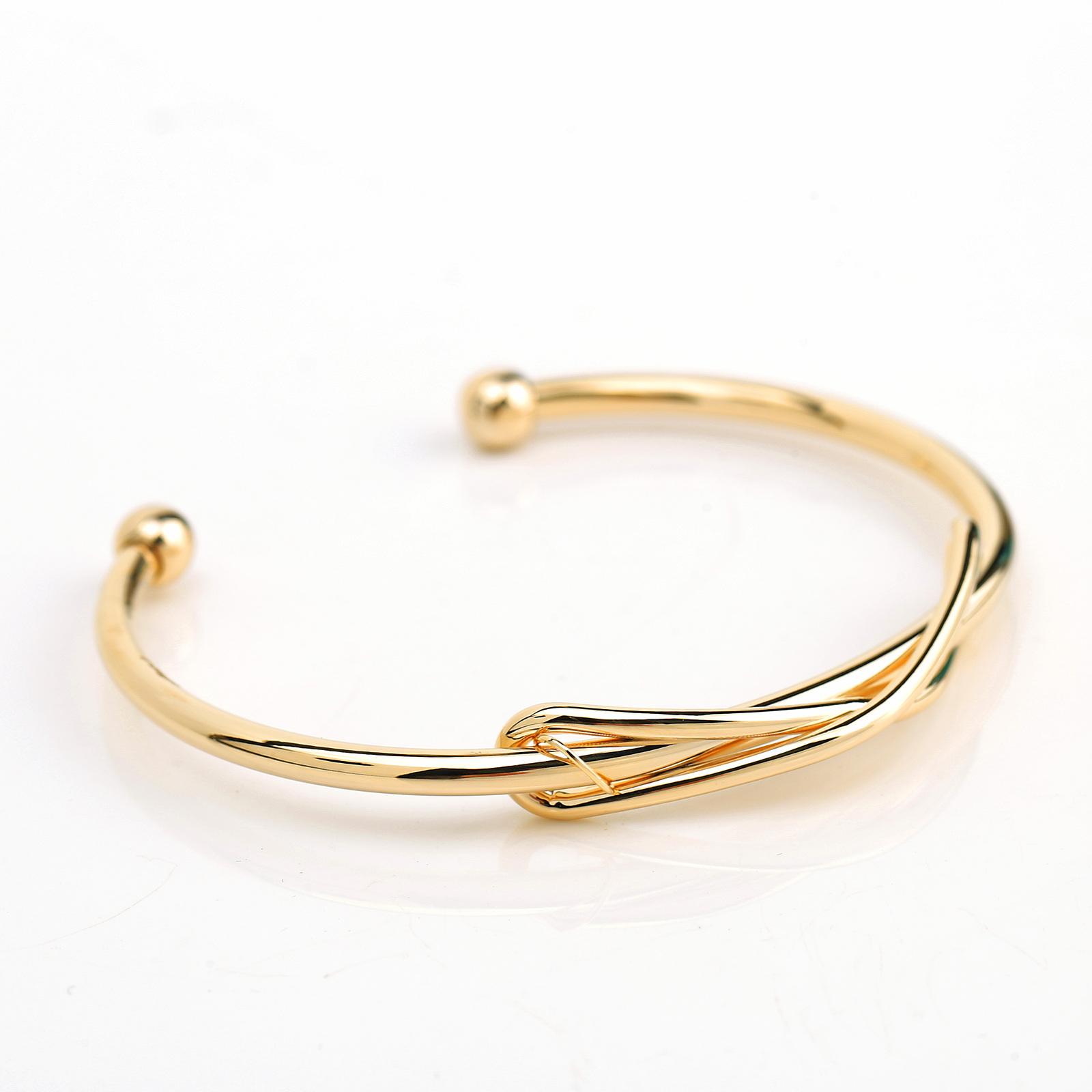 UE- Trendy Gold Tone Designer Bangle Bracelet With Contemporary Infinity Design