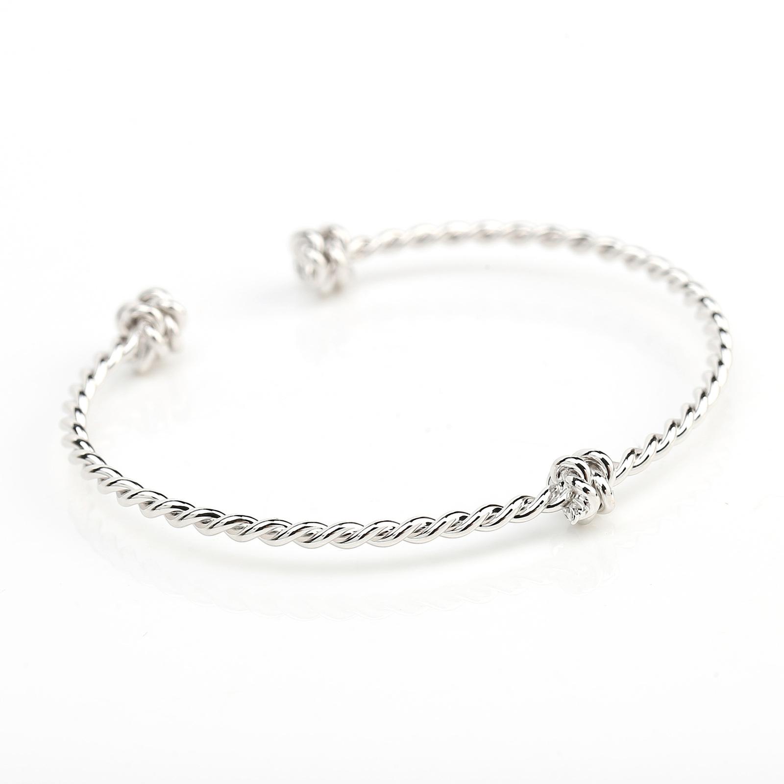 UE- Stylish Silver Tone Designer Twisted Bangle Bracelet With Trendy Knot Design