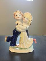 Fine Collectible Porcelain Figurine Boy Hugging Girl - $14.95
