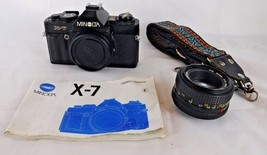 Minolta X-7 camera with 50mm lens, manual, and case for parts or repair - $29.99
