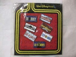 7 Piece Disney Pin Starter Set License Plates 2010 - $48.49