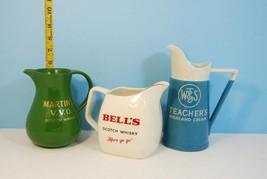 Lot of 3 Vintage Whiskey & Liquor Pitchers: Bell's, Martin's &  Teachers - $32.38