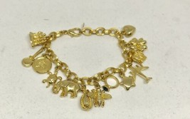 JOAN RIVERS CHARM BRACELET WITH 12 CHARMS GOLD TONE SIGNED VINTAGE - $64.35