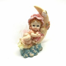 """Precious Moments """"Growing In Grace"""" Baby Girl holding a doll on the Moon - $37.95"""