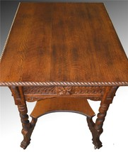 17108 Oak Carved Lion Face Library Table - $875.00