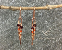 Handmade copper earrings: long narrow wire wrapped red orange yellow gla... - $24.00