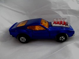 Matchbox no 40 Piston Popper 1973 Lensey  dark blue with amber glass - $24.74