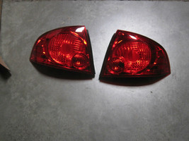NISSAN 265506Z525 Combo Lamp Assy RH And LH Pair New Genuine image 1
