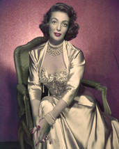 Loretta Young stunning gold outfit beaded jewelry in chair 11x14 Photo - $14.99