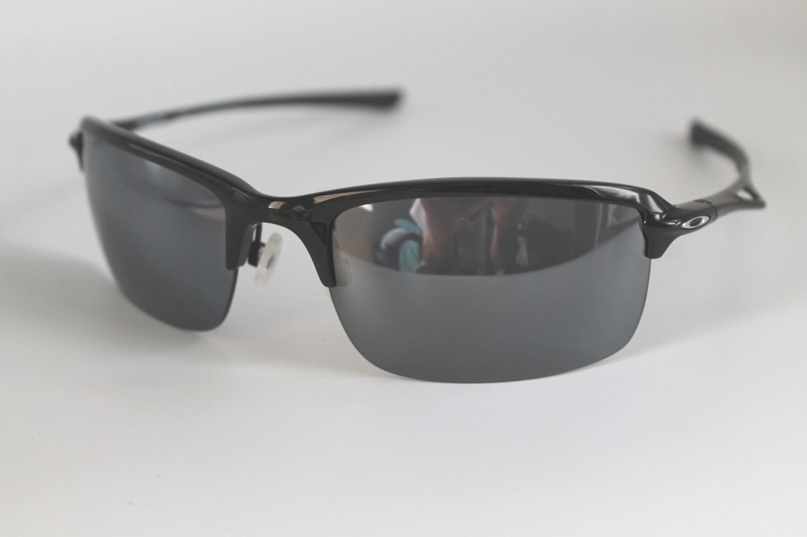 2b6d3f31288 57. 57. Previous. Oakley Wiretap Sunglasses OO4071-01 Polished Black Frame  W  Black Iridium Lens