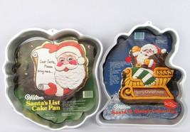 "Lot of 2 Wilton Santa""N Sleigh & Santa's List cake pan 1982 &1984 Christmas - ₹1,204.48 INR"