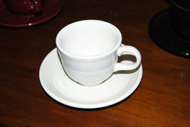 Fiesta white cup and saucer - $1.98