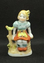 Vintage Porcelain Figurine of Girl Sitting on Bench with Bird - Occupied... - $7.60