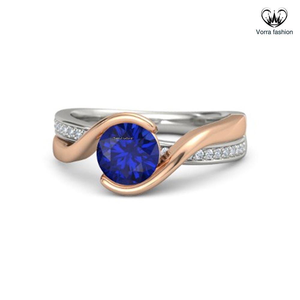 Round blue sapphire 14k white gold ring with diamond