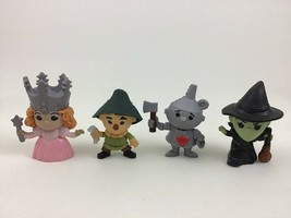 Wizard of Oz 75th Anniversary McDonalds Lot 4pc Figure Toys Tin Man Scarecrow - $14.80