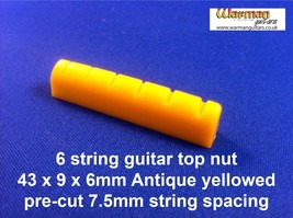 Aged / yellowed Top Nut / Bridge 43 x 9 x 36mm - UK SUPPLIER - $2.43