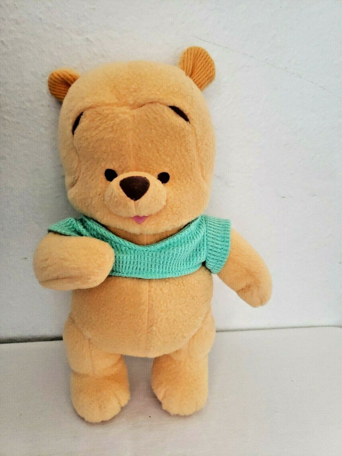 Primary image for Fisher Price Baby Winnie the Pooh  2001 Green Shirt Rattle Plush Stuffed Animal