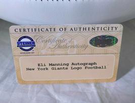ELI MANNING / AUTOGRAPHED NEW YORK GIANTS LOGO WHITE PANELLED FOOTBALL / STEINER image 5