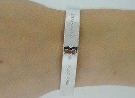 TIFFANY & CO. Sterling Silver Key Lock Bangle Bracelet with Diamonds - $390.00