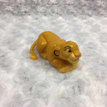 VTG 1990s Disney Lion King Simba Moving Wind up Wheel Toy w Spinning Tai... - $8.59