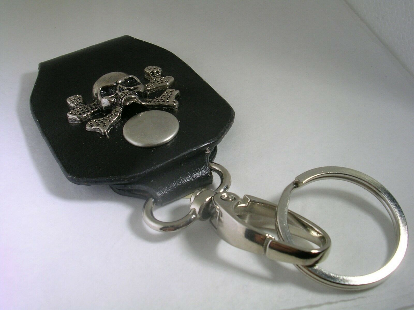 Primary image for SKULL & BONES LEATHER KEY CHAIN WITH A HIGH POLISHED FINISH IN STAINLESS STEEL