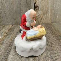 Vintage Kneeling Santa Music Box Jesus Christ Manger with Santa Claus Ro... - $109.99