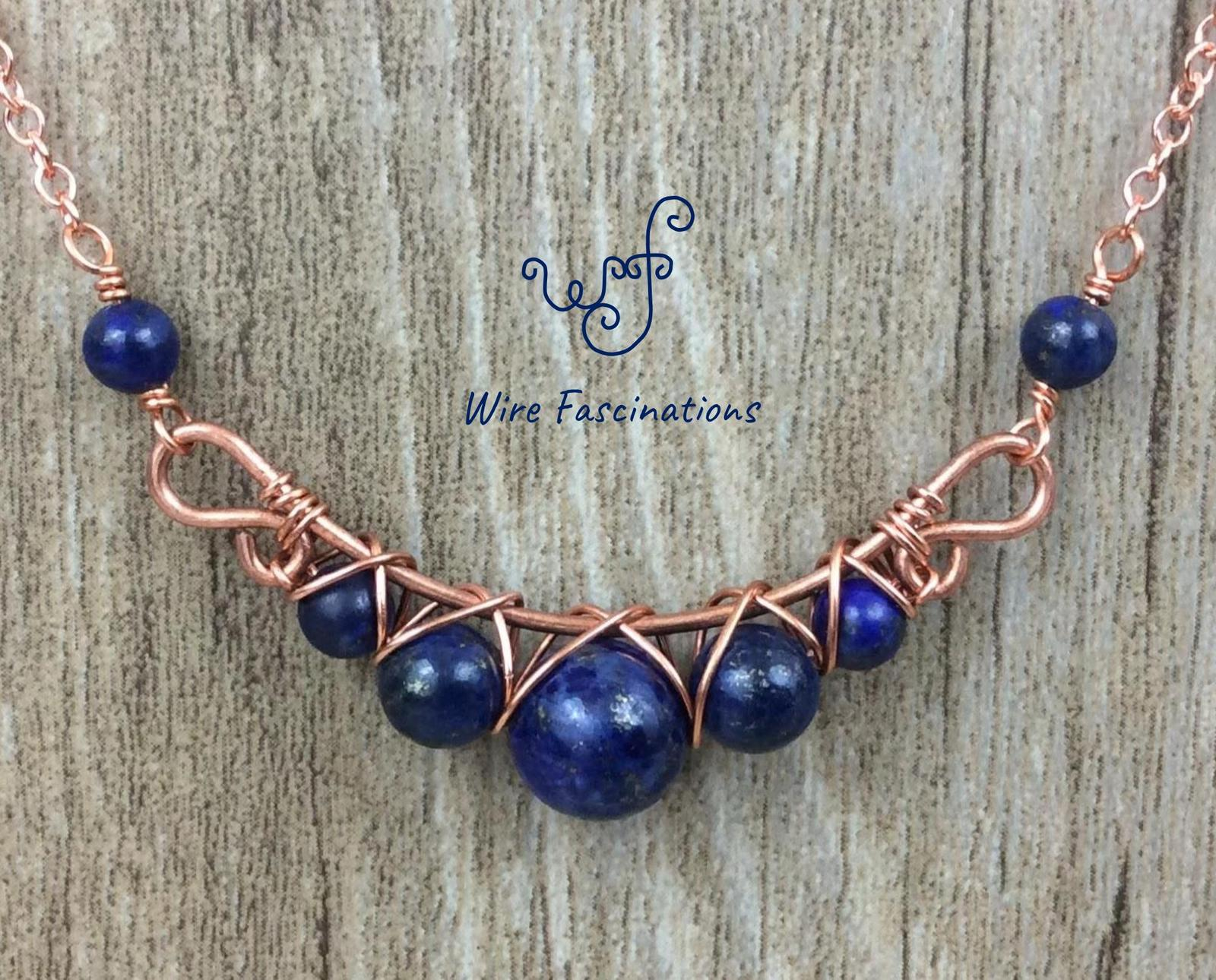 Handmade lapis lazuli necklace: criss cross copper wire wrapped