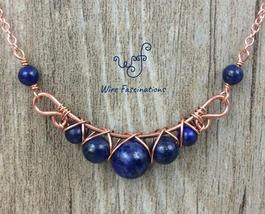 Handmade lapis lazuli necklace: criss cross copper wire wrapped - $35.00
