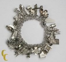 Unique Sterling Silver Charm Bracelet with 35 Charms - $594.00
