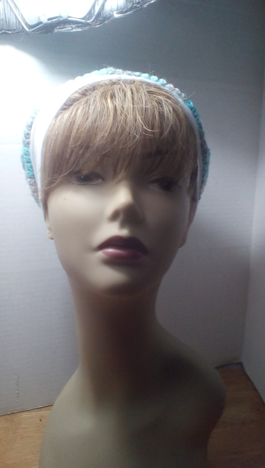 Blue, green, white and gray with white headband winter hat.  With matching scarf