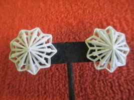 White Open Snowflake Monet Signed Clip Earrings Paddle Back Vintage Midcentury - $18.00