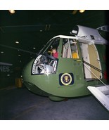 JFK Jr. sits in the cockpit of Marine One helicopter 1963 - New 8x10 Photo - $8.81