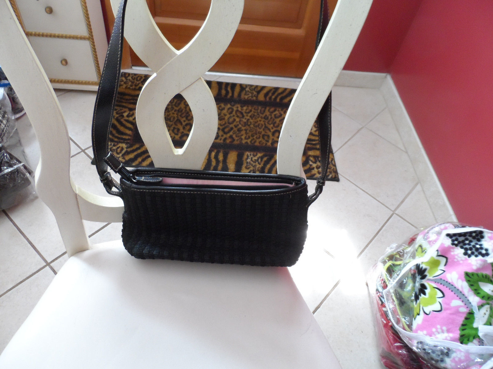 Ladies black woven handbag with pink lining from Liz Claiborne - $11.00