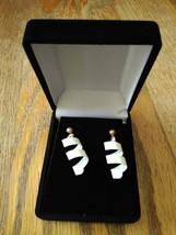Vintage White Metal Swirl Dangle Earrings - $11.99