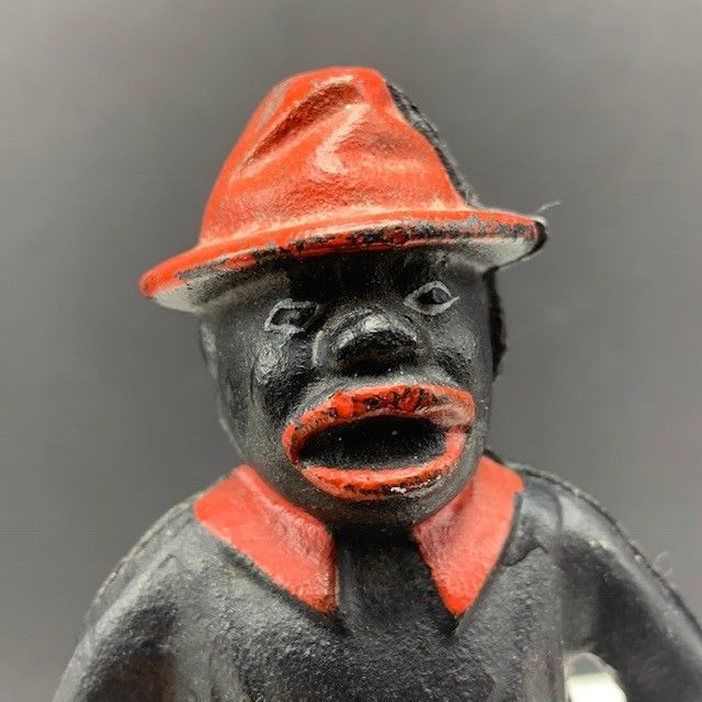 Black Americana cast iron bank give me penny red hat figurine antique statue usa